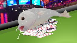 fish lying on a pile of poker cards
