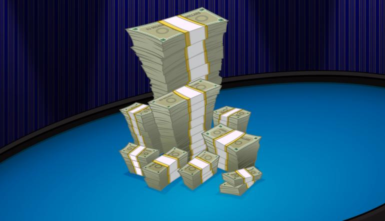 Pile of bills on a cash poker table